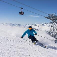 skiier on the piste